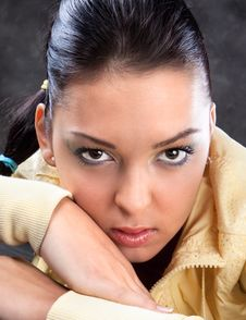 Free Pretty Brunette In Yellow Posing Stock Photo - 15501710