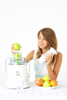 Free Girl Squeezes The Juice From The Juicer Stock Photography - 15504312