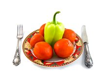 Peppers And Tomatoes On Plate On White Bacground Royalty Free Stock Photography