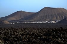 Free Village Yaiza Seen From Volcanic Landscape Royalty Free Stock Photo - 15508485
