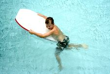 Boy On Surfboard In Pool Royalty Free Stock Photo