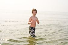 Free Young Boy In The Sea In Cold Water Royalty Free Stock Image - 15511486