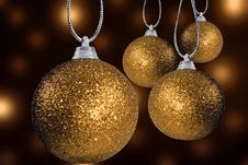 Free Golden Christmas Baubles On Strings Royalty Free Stock Photography - 15513557