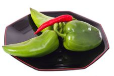 Green Peppers And Red Chili On The Black Plate Royalty Free Stock Images