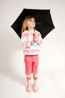 Lovely Girl Looking Out Under Her Umbrella Stock Image