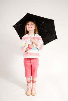 Free Lovely Little Girl Looking Up From Under Umbrella Royalty Free Stock Images - 15514009
