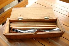 Spoons And Chopsticks In Box Royalty Free Stock Photography