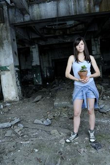Free Concerned Teenager Holding Flower Pot Stock Photography - 15516982