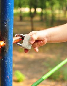 Free Child S Hand Touched The Closed Lock Royalty Free Stock Photography - 15519167
