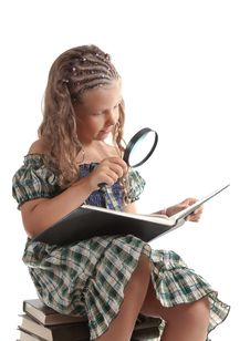 Little Girl Holding Magnifying Glass Stock Photo