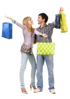 Free Beautiful Young Couple With Shopping Bags Stock Images - 15519984