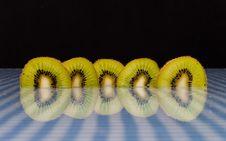 Free Kiwi Slices With Reflection Stock Image - 15522561