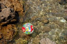 Ball On Adriatic Water Royalty Free Stock Image