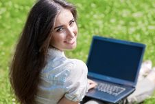 Free Young Woman With Notebook On Grass Royalty Free Stock Photos - 15523228