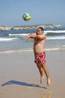 Free Fat Man Playing With A Ball On The Beach Royalty Free Stock Photo - 15525055
