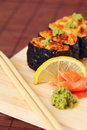 Free Sushi And Rolls On The Wooden Plate Stock Photo - 15531020