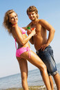 Free Young Couple With Cocktails On The Seaside Stock Photos - 15539453