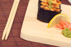 Free Sushi And Rolls On The Wooden Plate Stock Images - 15530894