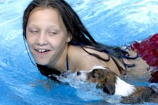 Free Girl Swimming With Her Dog Royalty Free Stock Images - 15531369