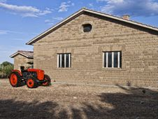 Free Aged Red Tractor Near Empty Farm Stock Photo - 15532300