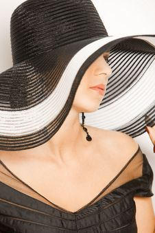 Fashion Girl In A Big Hat In The Studio Stock Image