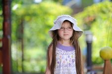Free Toddler Girl In Sun Hat On The Green Background Stock Photos - 15536163