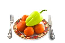 Peppers And Tomatoes On Plate On White Bacground Royalty Free Stock Photo