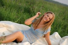 Free Girl Sitting On Green Grass Royalty Free Stock Photography - 15537357