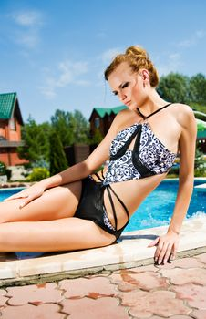 Free Girl With The Background Of A Pool Royalty Free Stock Photo - 15537955