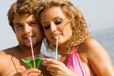 Free Young Couple On The Seaside With Cocktails Stock Photography - 15539432