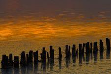 Breakwaters At An Orange Sunset Stock Photo