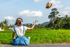 Free Tropical Portrait Of Young Happy Woman With Straw Hat On A Road With Coconut Palms And Tropical Trees. Bali Island. Royalty Free Stock Photos - 155396638
