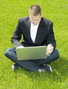 Free Young Businessman Sitting On Grass With Laptop Royalty Free Stock Photo - 15541715