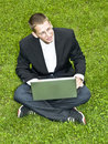 Free Young Businessman On The Grass With His Laptop Stock Photo - 15541890