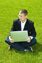 Free Businessman On Grass With Laptop, Mixed Feelings Stock Images - 15542524