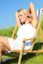 Free Blond Girl Chilling In A Sunchair Stock Photos - 15548723