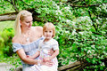 Free Mother And Daughter In Blooming Garden Royalty Free Stock Photography - 15549797