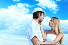 Free Couple Over Blue Sky Stock Photography - 15540252
