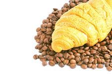 Free Fresh Croissant Over Heap Of Coffee Beans Royalty Free Stock Images - 15540789