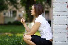 Free Girl Blows On A Dandelion Royalty Free Stock Images - 15541819