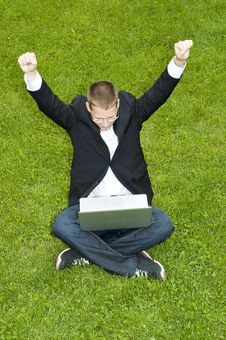 Free Happy Businessman On The Grass With Laptop Royalty Free Stock Photos - 15542098
