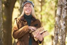 Free Woman Outdoors In Autumn Woodland Gathering Logs Royalty Free Stock Photography - 15542117