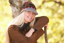 Young Woman Outdoors Walking In Autumn Woodland Stock Photography