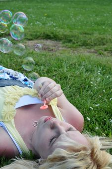 Free Girl Blowing Bubbles In Grass Stock Photos - 15548303