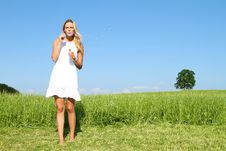 Beautiful Blond Girl Palying With Soap Bubbles Stock Photography