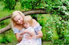 Free Mother And Her Daughter In Blooming Garden Stock Image - 15549971