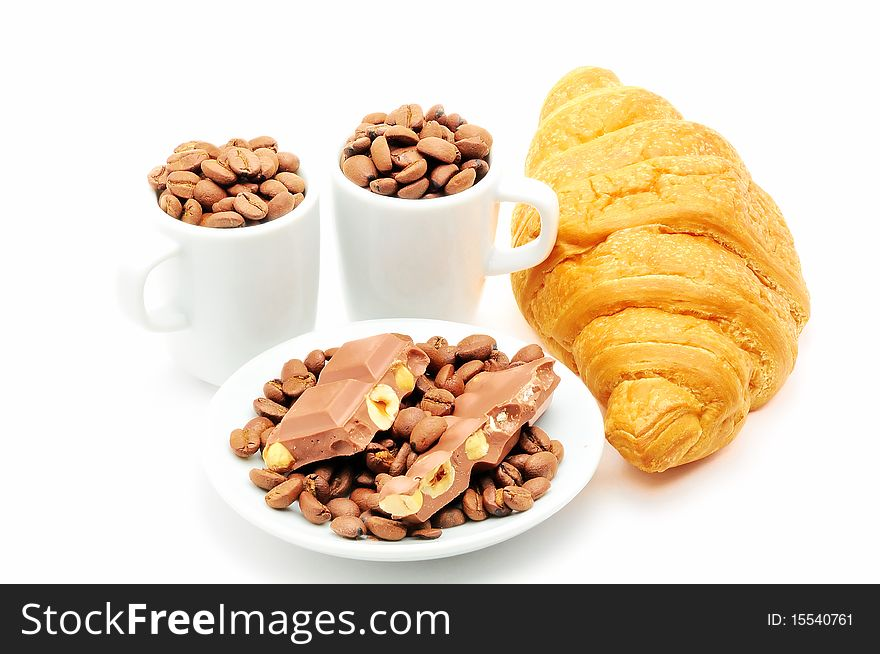 Cups with coffee and croissant