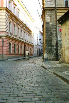 Free Men Is Walking  Between Houses Royalty Free Stock Image - 15550046