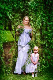 Free Mother And Her Daughter In The Garden Stock Image - 15550241