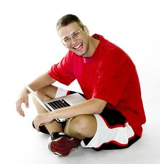 Free Young Man Sitting With Laptop, Laughing Royalty Free Stock Photography - 15550397